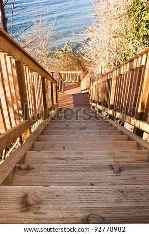 new wooden stairs between bushes on the beach - stock photo