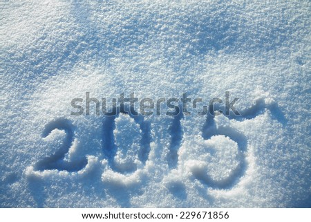 new year and christmas background,text  2015 on the snow