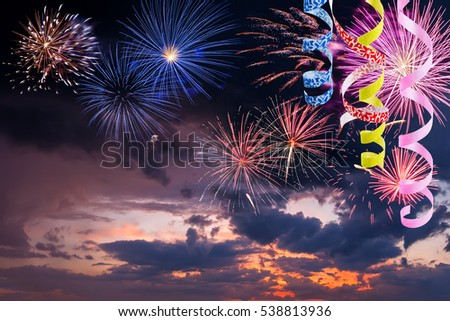 New Year and Christmas background with fireworks and serpentine