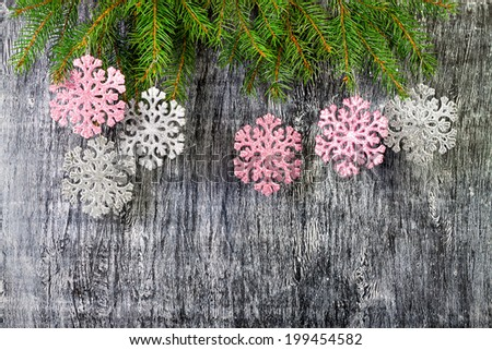 new year background from branches of a fir and snowflakes - stock photo