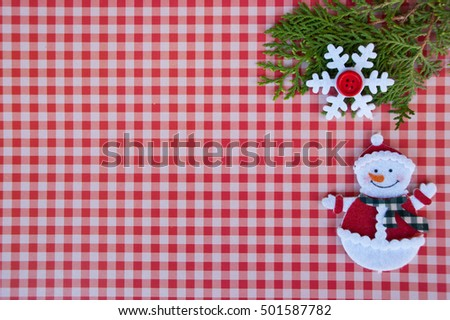 New year background with xmas tree, snowflake and  snowman on red paper plaid. Christmas card idea.Space for text.Xmas blank.