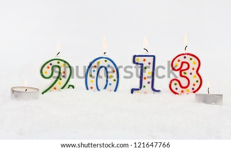 new year 2013 - candles with snow isolated on white - stock photo