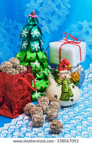 New Year card. Christmas tree, snowman, gifts, candy on a blue background - stock photo