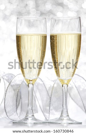 New year card with Champagne on shiny glitter background