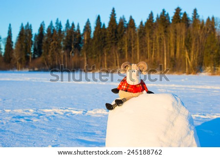 New year card with sheep a symbol of 2015 on snow outdoor - stock photo
