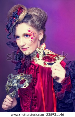 New Year Carnival.Young charming woman in artistic image posing with mask - stock photo