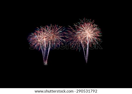 New Year celebration fireworks black background - stock photo