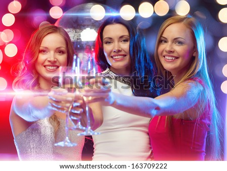 new year, celebration, friends, bachelorette party, birthday concept - three beautiful woman in evening dresses with champagne glasses