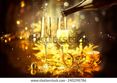 New Year celebration with champagne. Champagne Christmas and New Year celebration. New Year holiday decorated table. Two Champagne Glasses  - stock photo
