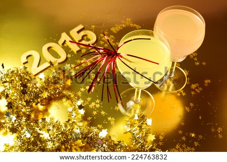 New Year celebration with cocktail glasses - stock photo