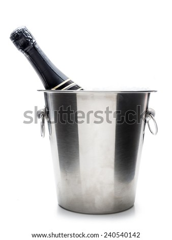 New Year champagne bottle in metal cooler shot on white - stock photo