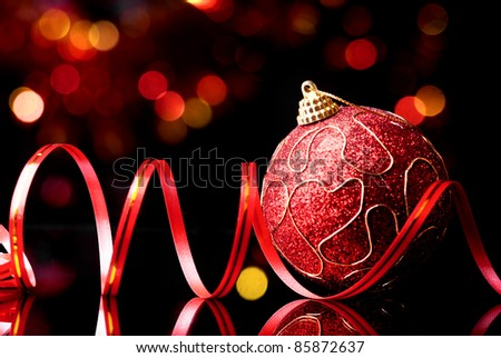 New year,christmas toy and decorative ribbon on abstract shine background - stock photo