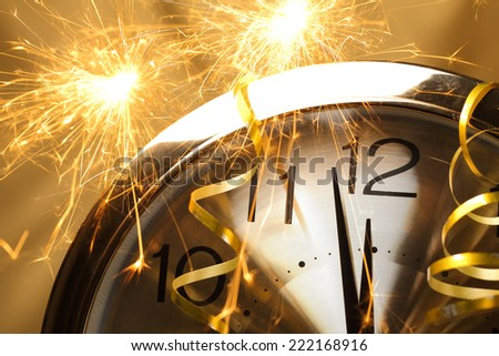 New year clock with fireworks - stock photo