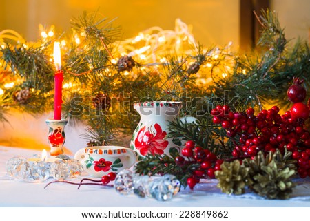 New Year composition in Russian national traditional style with tableware and candles - stock photo