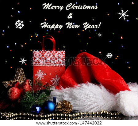 New Year composition of New Year's decor and gifts on  lights background - stock photo