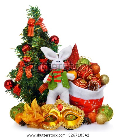 New year composition with christmas tree santa bag rabbit and mask isolated over white - stock photo