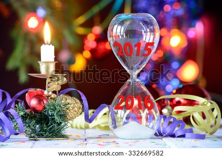 New Year 2016 concept with hourglass and Christmas decoration - stock photo