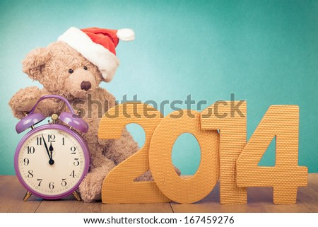 New Year date, retro clock, Teddy Bear in Santa hat for greeting card background - stock photo
