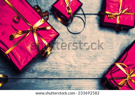 New Year decoration box with gift red and vintage on wooden background  - stock photo