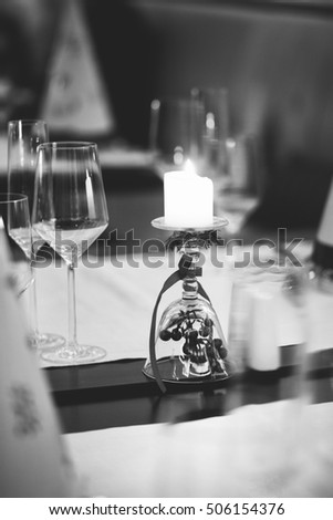 New year decoration of table setting with wine glasses and candle, white and black, Christmas, xmas, celebration, family, business, diner in the cafe, shallow focus, holiday,  December of 2016, 2017