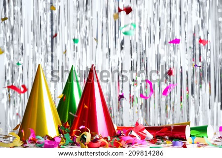 New year decoration with hats and streamers - stock photo