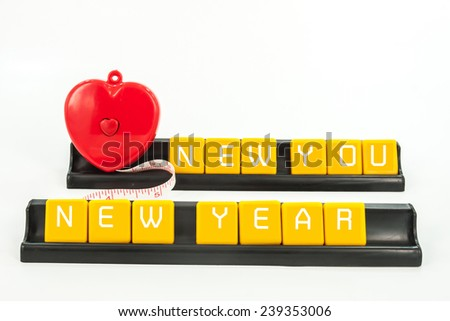 new year decoration with letter and tape measure  on white background, diet concept. - stock photo