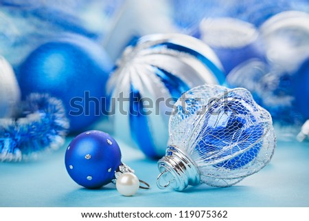 New Year decorations ball on blue blurred background