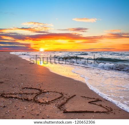 new year 2013 digits on ocean beach sand - stock photo