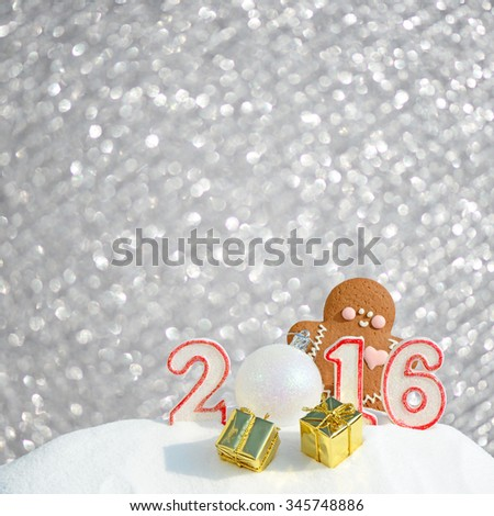 New Year 2016. Figure 2016, Christmas balls, gifts and gingerbread man on silver glitter background - stock photo