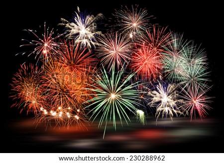 New Year fireworks on black - stock photo