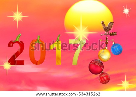New Year 2017.Fun Numbers are made of colorful Bell pepper.Colorful bright baubles and symbol rooster against the sunny festive fiery sky with sparkles and shining stars.Abstract holiday background