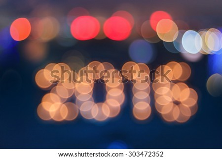 new year greeting card made of colorful bokeh digits in shape of 2016 - stock photo