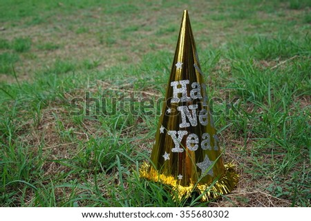New year hat on the grass - stock photo