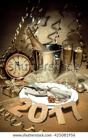 New year holiday table setting with champagne. Celebration. Place setting for new year eve. Holiday decorations. Served table - stock photo