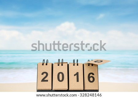 New Year 2016 is coming concept. Happy New Year 2016 replace 2015 concept on the sea beach with copy space for your idea. - stock photo