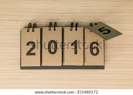 New Year 2016 is coming concept. Happy New Year 2016 replace 2015 concept on wooden background. - stock photo