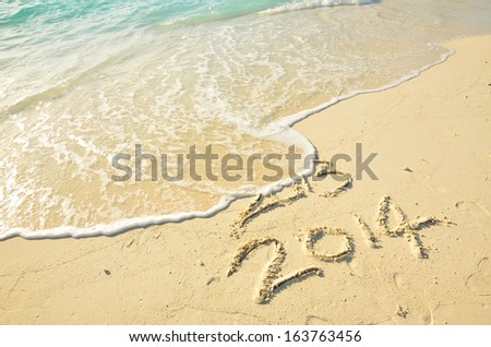New Year 2014 is coming -- 2014 replace 2013  - stock photo