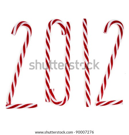 new year 2012 made of christmas lollipop cane isolated on white - stock photo