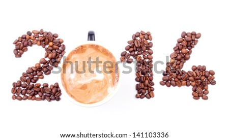 New Year 2014 made of coffee beans and cup of coffee on the white background - stock photo