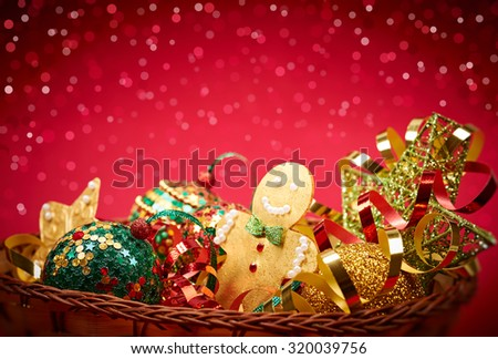New Year 2016. Merry Christmas. Party festive decoration, gingerbread balls stars serpentine, in basket, handmade, bokeh. Happy holiday. Vivid greeting card, multicolored, green red gold, copyspace - stock photo