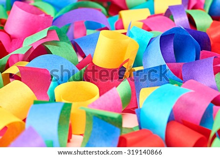 New Year 2016. Merry Christmas. Party festive decoration, lot of paper serpentine, multicolored background. Vivid colorful greeting card, copyspace. Cheerful happy winter holiday with tinsel. Close up - stock photo
