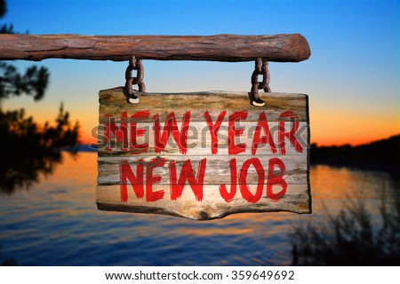 New year new job motivational phrase sign on old wood with blurred background - stock photo
