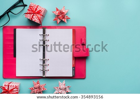 new year note and blank colorful paper notebook on cyan blue background, new year resolution concepts - stock photo