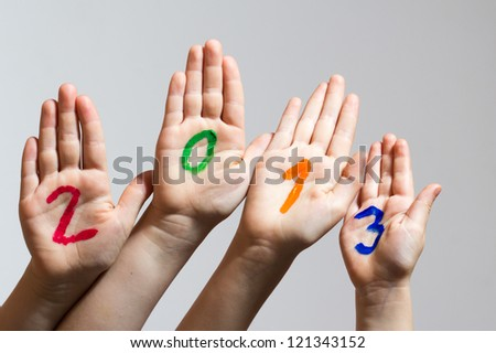New Year 2013 - numbers on the hands - stock photo