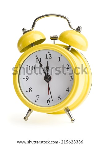 new year on a yellow alarm clock - stock photo