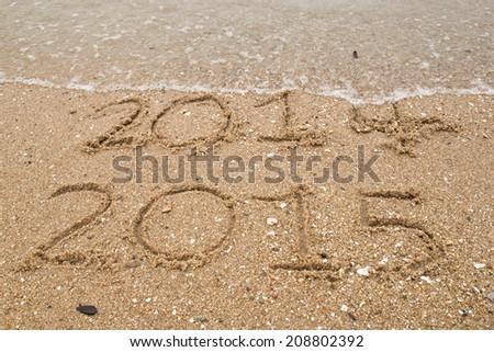 New Year 2015 replace 2014 concept on the sea beach - stock photo