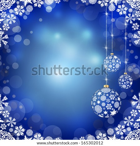 New Year's background. Christmas balls and snowflakes on a blue background
