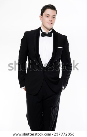 New year's eve fashion man wearing black dinner jacket. Isolated against white.