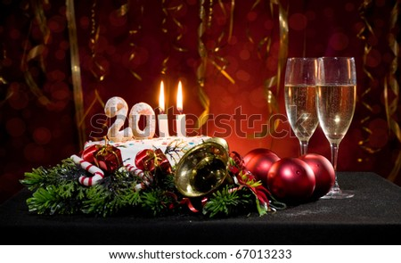 New Year's Eve with a cake with candles and other Christmas decorations - stock photo