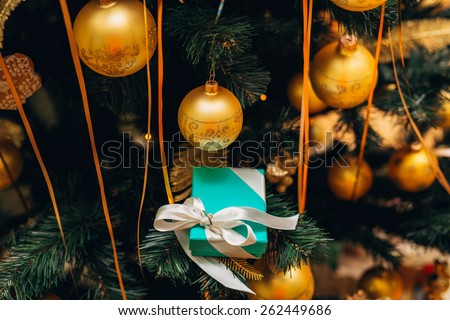 New Year's gift on the Christmas tree - stock photo